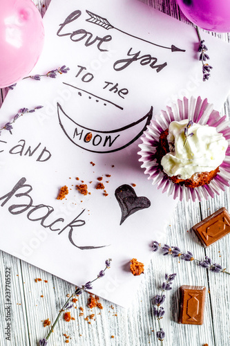 concept of Valentine's Day cupcakes wooden background top view - 237705522