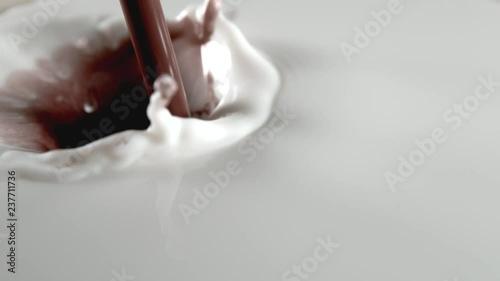 Super slow motion of pouring chocolate into milk, filmed with macro lens. Filmed on very high speed camera, 1000 fps.