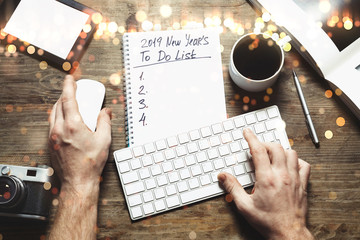 New year  2019 Goals Concept. Notepad with To do list, tablet, pen, keyboard and cup of coffee, top view, flat lay. Workplace of freelance designer, blogger, photographer
