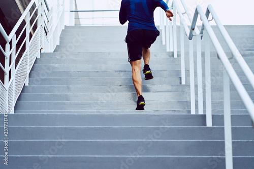Leinwanddruck Bild Fitness, health, and sport concept. Athletic man running upstairs