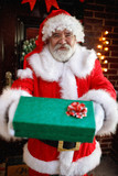 Santa Claus gives a gift - 237750530
