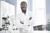 The scientist works with a microscope in a laboratory conducting experiments and formulas. - 237750901