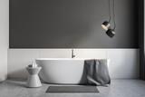Gray and white bathroom interior, white tub