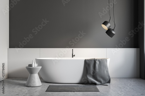 Gray and white bathroom interior, white tub - 237784965