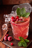 Raspberry drink with ice and cinnamon