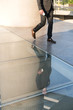 Business person walking on glass flooring