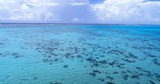 Beautiful seascape against sky. Amazing turquoise lagoon at tropical beach. Aerial drone video from French Polynesia. Travel, vacation and summer holiday concept. - 237811791