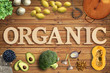 "Leinwanddruck Bild - Word ""Organic"" in wooden letters with many cooking ingredients"