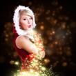 Leinwanddruck Bild - attraktive Miss Santa pustet Sternenstaub