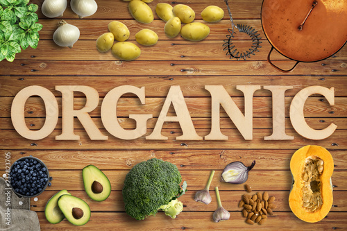 "Leinwanddruck Bild Word ""Organic"" in wooden letters with many cooking ingredients"
