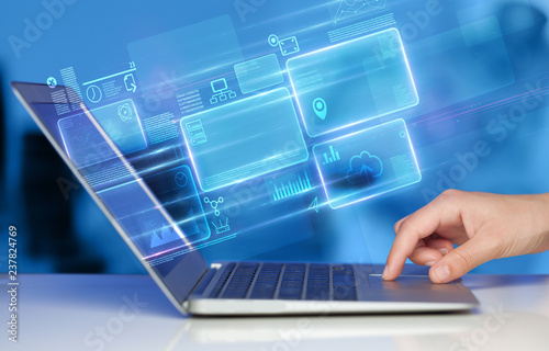 Leinwandbild Motiv Hand using laptop with database reports and online work concept