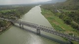 Aerial footage passing long bridge view cross green river and traffic - 237836384