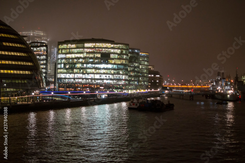 City hall and other official commercial buildings on river thames Photo by promicrostockraw