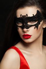 Sexy brunette woman in carnival mask, female face closeup