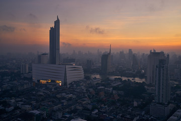 cityscape on sunrise skyline with cloud and fog © bank215
