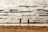 Happy children playing at the beach at sunset © TeamDaf