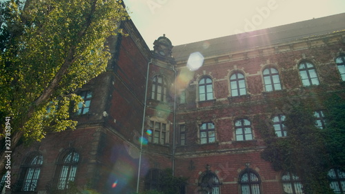 obraz lub plakat Horizontal Panorama of Historic Building of Museum from Red Brick with Ivy and Sun Flare in Wroclaw, Poland