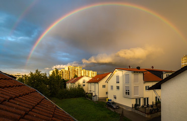 Rodgau, Germany - September 11, 2017: Glowing double rainbow during sunset, photographed through a polarizer.