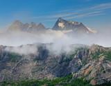 high mountain ridge in a dense clouds