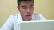 Man Using Computer at Dusk