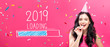 Leinwandbild Motiv Loading new year 2019 with young woman with party theme on a pink background