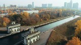 Sluice Gates on the River. Aerial view barge, ship in the river gateway. The movement of ships and barges along the canal through the river gateway in autumn sunny day. - 237943995
