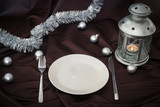 empty plate on dark linen witch christmas balls and lantern - 237951132