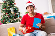 Leinwanddruck Bild - Young student with book at Christmas eve