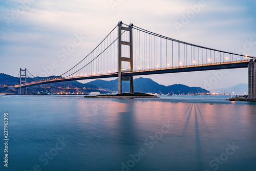Bridge to Park island at sunset time. Hong Kong.