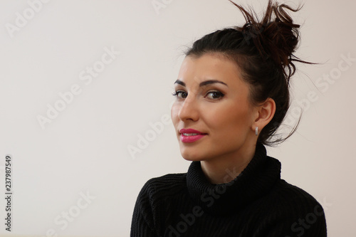 A young woman look on the window - 237987549