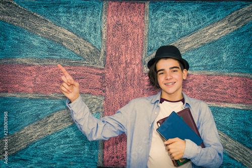 Leinwanddruck Bild student with books and english flag, learn english