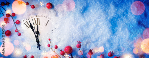 Waiting Midnight - Happy New Year With Clock And Berries On Snow