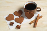 Coffee, heart shaped ginger cookies and spice