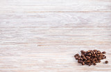 coffee beans on a light wooden table