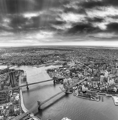 Aerial view of Manhattan and Brooklyn Bridge from helicopter, New York City in winter © jovannig
