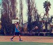 Man on a basketball outdoor court