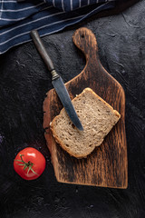 Slice of bread on a chopping board.