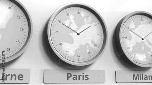 Focus on the clock showing Paris, France time. Conceptual 3D animation