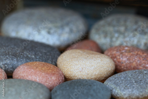 multicolored decorative stones, close up, blurry background - 238029302