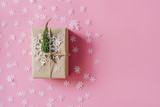 Brown gift box on the pink background with christmas decoration. Minimal styled holiday card with copy space. - 238030919