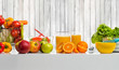 still life cfreshly squeezed juice, fruit and vegetables on table