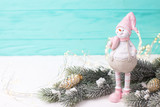 Little decorative  snowman toy, fir spruce and fairy lights on bright wooden  background. - 238042114