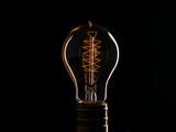 Edison's light bulb illuminates from electric current - 238042326