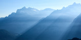 Panorama view of morning sunlight between mountain peaks in Grindelwald in Switzerland. - 238043392