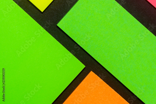 Green, yellow, orange and rose hue colorful office stickers on black paper. Office noteparer as reminder. Isolated on black paper. - 238043359