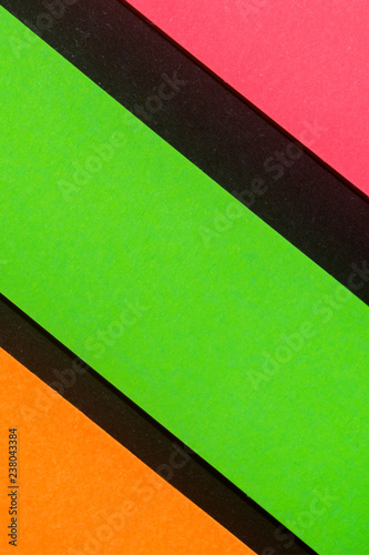 Leinwandbild Motiv Green, orange and rose hue colorful office stickers on black paper. Office noteparer as reminder. Isolated on black paper.