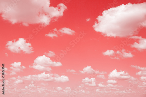 Gradient Living Coral color of the Year 2019. Sky with fluffy clouds. Retro toned abstract background, minimal.