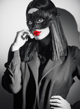 Beauty sexy brunette woman portrait. Girl wearing carnival black feather mask. Black hair, red lips, holiday makeup. Black and white fashion portrait - 238048322