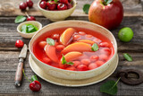 Sweet fruit soup with cherries, apples and mint - 238048937