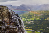 mountain landscape with hydenfossen waterfall, the end of earth, rainbow